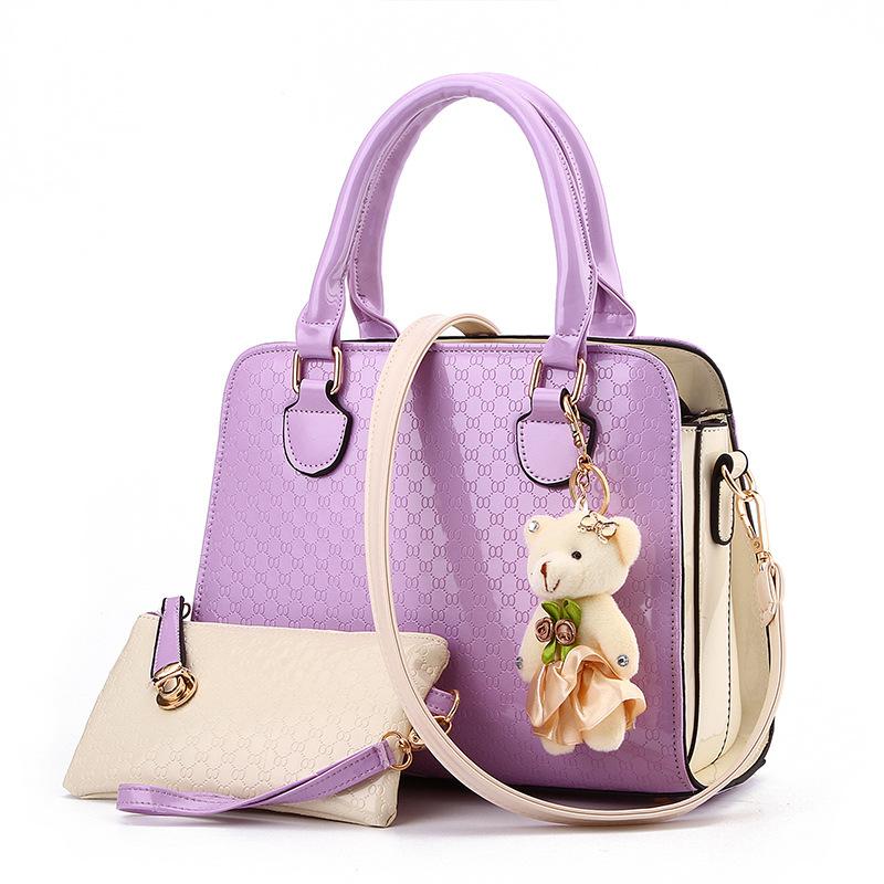 Pre-order ขายส่งกระเป๋าผู้หญิงถือและสะพายข้าง เช็ต 2 ใบหนังPUลาย OOแฟชั่นสไตล์ยุโรป รหัส Yi-8742 สีม่วง *แถมตุ๊กตาหมี