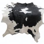 หนังแท้ หนังขนลูกวัว ใช้สำหรับตกแต่งฝาผนังบ้าน หรือ ใช้เป็นผ้าปูโต๊ะแล้วเอากระจกทับ หรือ ผ้าคลุ่มเก้าอี้นั่ง