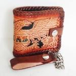กระเป๋าสตางค์หนังแท้ ทำจากหนังวัว ด้านขอบกระเป๋าเป็นหนังถักตลอดขอบกระเป๋าพร้อมโซ้